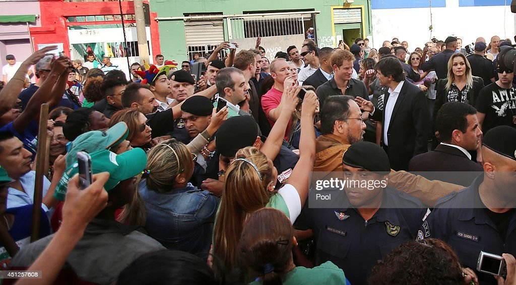 Prince Harry is seen during his visit to the Open Arms project which helps reduce crime and drug abuse in 'Cracolandia', an extremely deprived area of Sao Paulo with a high concentration of crack addicts on June 26, 2014 in Sao Paulo Brazil. Crack in Sao Paulo costs just 80 UK pence for a rock of the drug. Prince Harry is on a four day tour of Brazil that will be followed by two days in Chile.