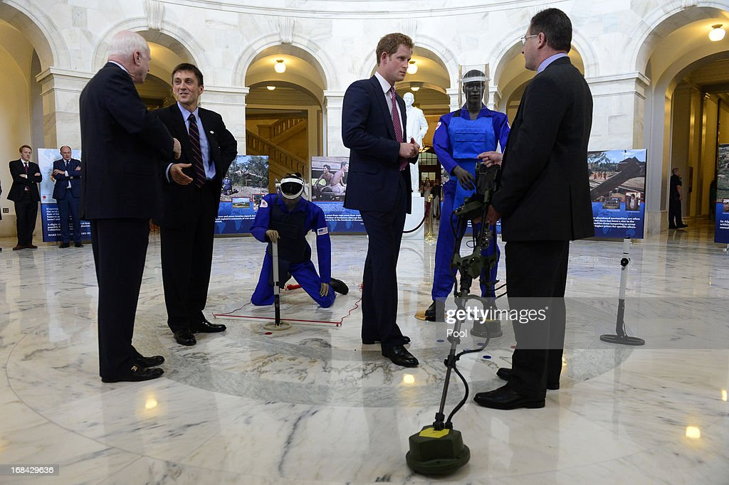 Prince Harry (2-R) is shown a ground penetrating radar, a tool used for detecting land mines, during a tour of a HALO Trust photo exhibit on landmines and unexploded ordinances, with HALO Trust Weapons and Ammunition Disposal Desk Officer Richard Boulter (R), Republican Senator from Arizona John McCain (L) and HALO Trust Afghanistan Desk Officer Tim Porter (2-L), on Capitol Hill on May 9, 2013 in Washington, DC. HRH will be undertaking engagements on behalf of charities with which the Prince is closely associated on behalf also of HM Government, with a central theme of supporting injured service personnel from the UK and US forces.