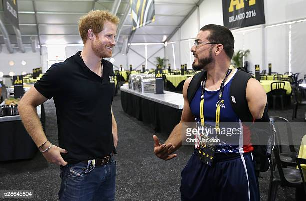 Prince Harry is shown contact lenses used by Team USA Athlete Michael Kacer ahead of Invictus Games Orlando 2016 at ESPN Wide World of Sports on May...