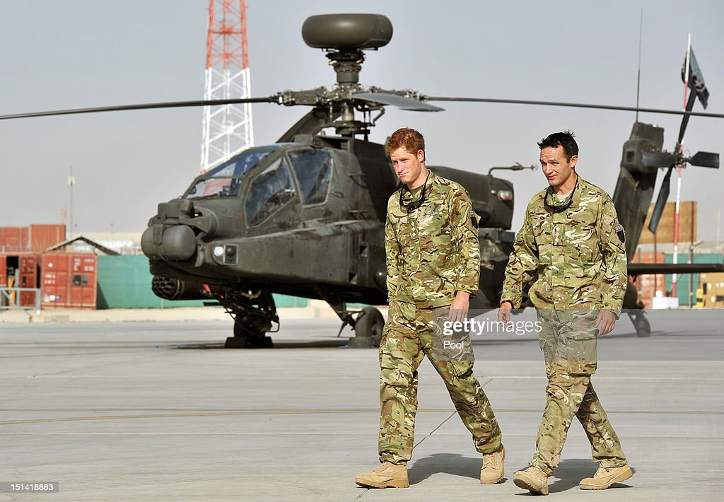 Prince Harry is shown the Apache flightline by a member of his squadron at Camp Bastion on September 7 2012 in Helmand Province Afghanistan Prince...