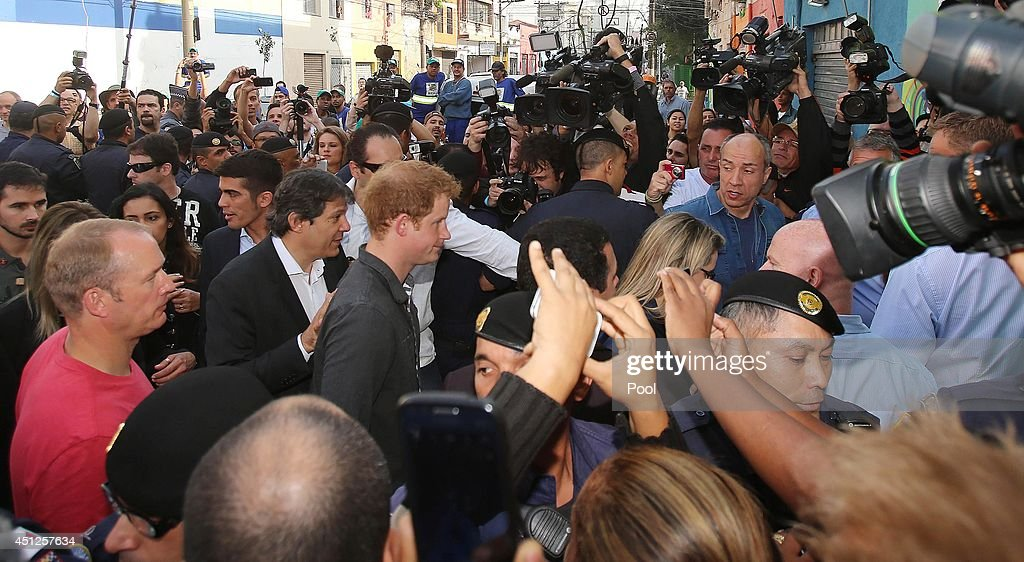Prince Harry is surrounded by the media during his visit to the Open Arms project which helps reduce crime and drug abuse in 'Cracolandia', an extremely deprived area of Sao Paulo with a high concentration of crack addicts on June 26, 2014 in Sao Paulo Brazil. Crack in Sao Paulo costs just 80 UK pence for a rock of the drug. Prince Harry is on a four day tour of Brazil that will be followed by two days in Chile.