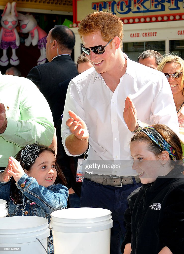 <a gi-track='captionPersonalityLinkClicked' href=/galleries/search?phrase=Prince+Harry&family=editorial&specificpeople=178173 ng-click='$event.stopPropagation()'>Prince Harry</a> joins children playing ball games on the Pier at Seaside Heights, New Jersey with Governor of New Jersey (not pictured) during his visit to Mantoloking, one of the areas affected by Superstorm Sandy on the fifth day of his visit to the United States on May 14, 2013 in Ocean Heights, New Jersey. HRH will be undertaking engagements on behalf of charities with which the Prince is closely associated on behalf also of HM Government, with a central theme of supporting injured service personnel from the UK and US forces.