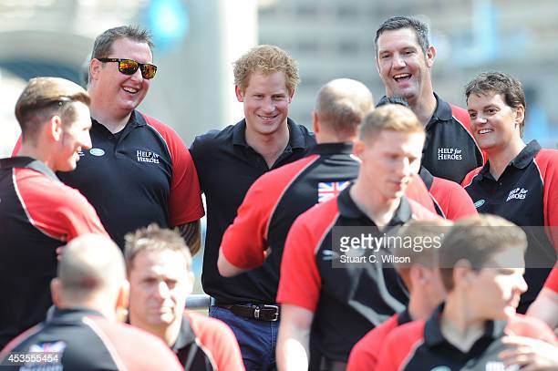 Prince Harry joins members of the British Armed Forces Team as thier unveiling For The Invictus Games at Potters Field Park on August 13 2014 in...