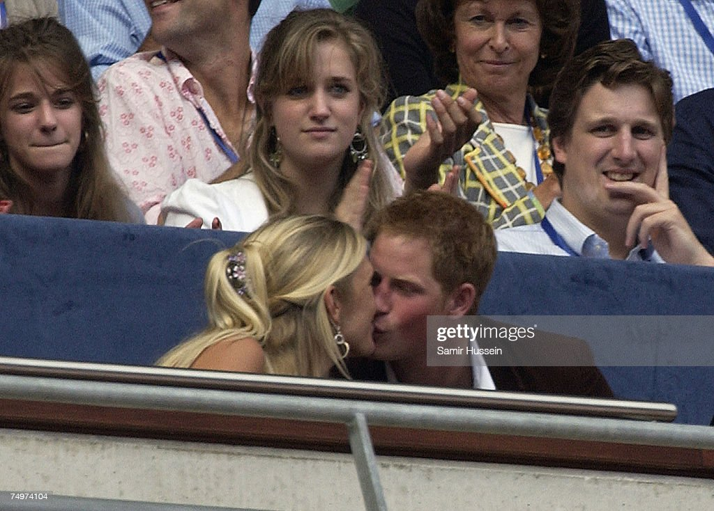 Prince Harry kisses girlfriend Chelsy Davy in the Royal box at The Concert for Diana on July 1, 2007 in London, England.