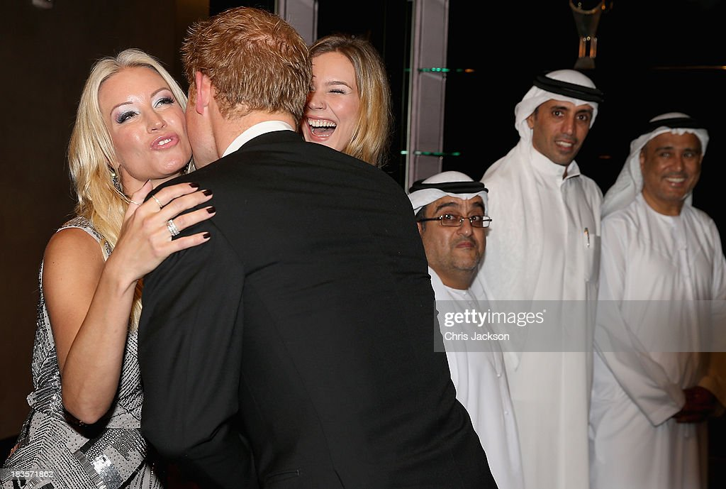 <a gi-track='captionPersonalityLinkClicked' href=/galleries/search?phrase=Prince+Harry&family=editorial&specificpeople=178173 ng-click='$event.stopPropagation()'>Prince Harry</a> kisses presenter <a gi-track='captionPersonalityLinkClicked' href=/galleries/search?phrase=Denise+Van+Outen&family=editorial&specificpeople=202834 ng-click='$event.stopPropagation()'>Denise Van Outen</a> as singer <a gi-track='captionPersonalityLinkClicked' href=/galleries/search?phrase=Joss+Stone&family=editorial&specificpeople=201922 ng-click='$event.stopPropagation()'>Joss Stone</a> looks on as he attends a reception ahead of the Sentable 'Forget Me Not' dinner on October 7, 2013 in Dubai, United Arab Emirates. The dinner is in partnership with the Al Jalila Foundation and aims to raise money for <a gi-track='captionPersonalityLinkClicked' href=/galleries/search?phrase=Prince+Harry&family=editorial&specificpeople=178173 ng-click='$event.stopPropagation()'>Prince Harry</a>'s Charity Sentebale which works with vulnerable children in Lesotho.