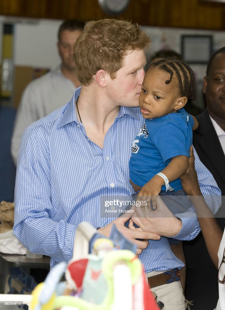 Prince Harry kisses young patient Tyrell Richards when he visits the childrens ward at the Queen Elizabeth ll hospital on January 30, 2010 in Bridgetown, Barbados. The Prince is visiting the island to launch and compete in the Sentebale Polo Cup to help raise funds to support Lesotho's vulnerable children.