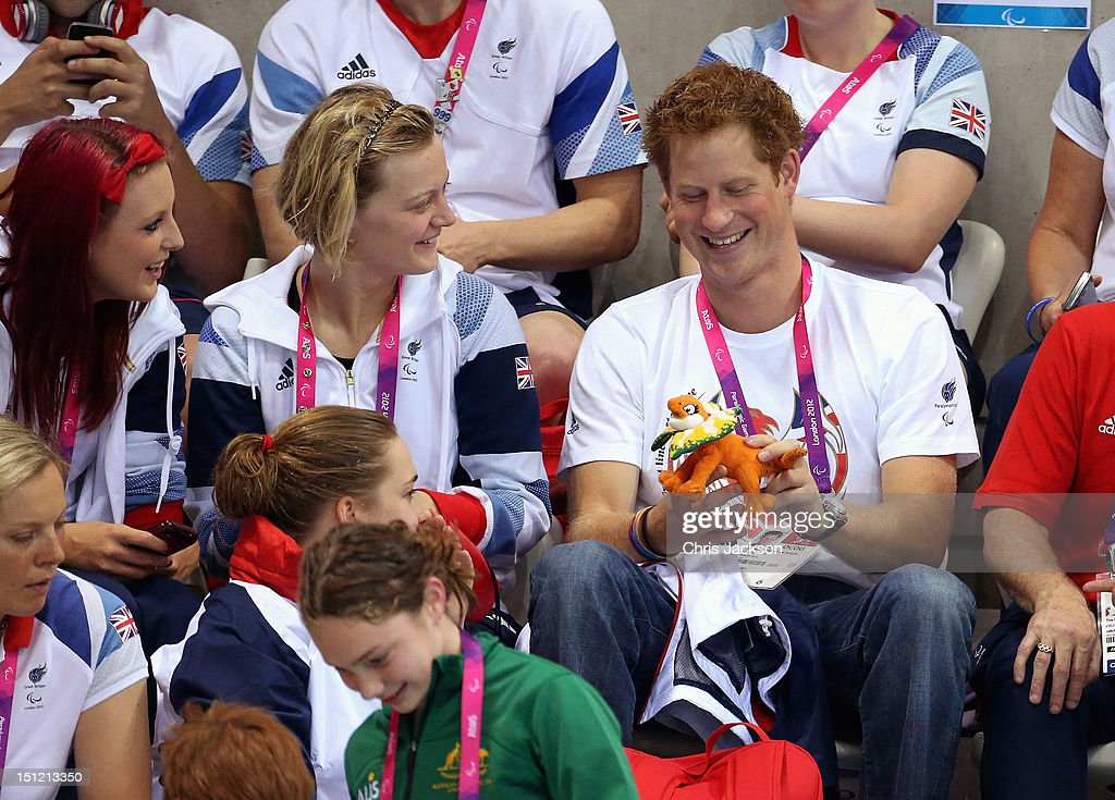 <a gi-track='captionPersonalityLinkClicked' href=/galleries/search?phrase=Prince+Harry&family=editorial&specificpeople=178173 ng-click='$event.stopPropagation()'>Prince Harry</a> laughs after being given a mascot by an Australian Paralympic athlete on day 6 of the London 2012 Paralympic Games at the Aquatics Centre on September 4, 2012 in London, England.