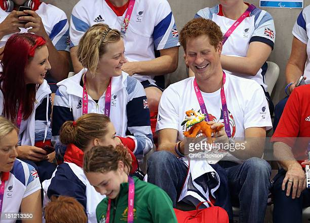 Prince Harry laughs after being given a mascot by an Australian Paralympic athlete on day 6 of the London 2012 Paralympic Games at the Aquatics...