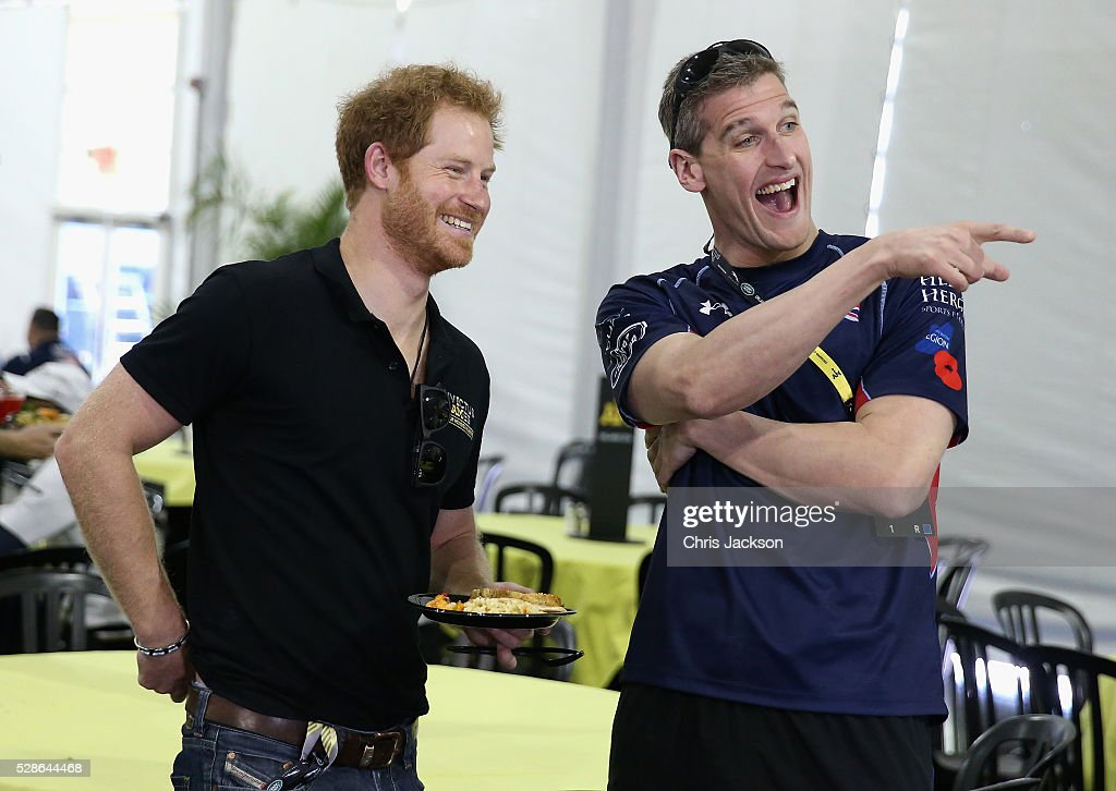 Prince Harry laughs with David Wiseman, Captain of the UK Armed Forces Team in the competitor's canteen ahead of Invictus Games Orlando 2016 at ESPN Wide World of Sports on May 6, 2016 in Orlando, Florida. Prince Harry, patron of the Invictus Games Foundation is in Orlando ahead of the opening of Invictus Games which will open on Sunday. The Invictus Games is the only International sporting event for wounded, injured and sick servicemen and women. Started in 2014 by Prince Harry, the Invictus Games uses the power of Sport to inspire recovery and support rehabilitation.