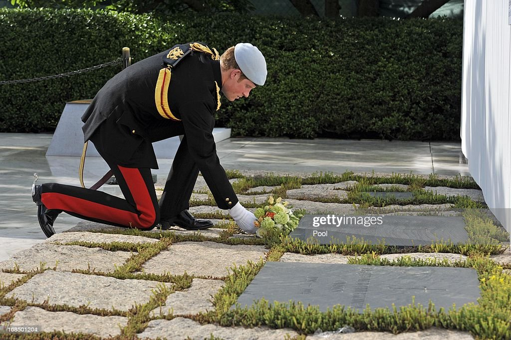 <a gi-track='captionPersonalityLinkClicked' href=/galleries/search?phrase=Prince+Harry&family=editorial&specificpeople=178173 ng-click='$event.stopPropagation()'>Prince Harry</a> lays a wreath at the JFK memorial during the second day of his visit to the United States at Arlington National Cemetery on May 10, 2013 in Arlington, Virginia. HRH will be undertaking engagements on behalf of charities with which the Prince is closely associated on behalf also of HM Government, with a central theme of supporting injured service personnel from the UK and US forces.