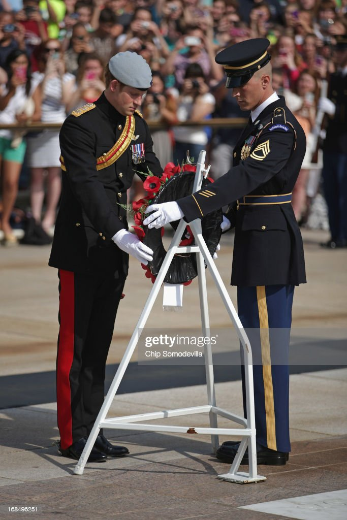 Prince Harry lays a wreath at the Tomb of the Unknowns during the second day of his visit to the United States at Arlington National Cemetery on May 10, 2013 in Arlington, Virginia. HRH will be undertaking engagements on behalf of charities with which the Prince is closely associated on behalf also of HM Government, with a central theme of supporting injured service personnel from the UK and US forces.