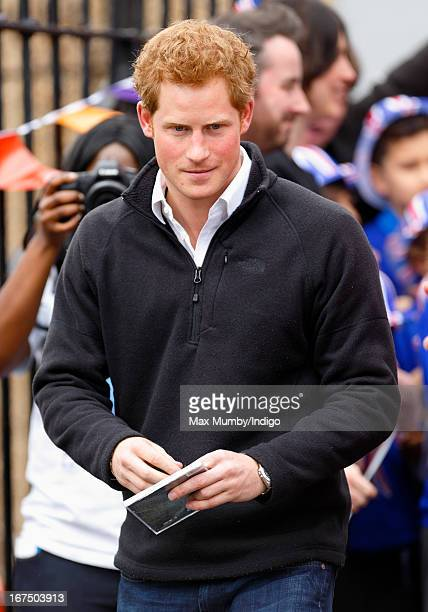Prince Harry leaves the Russell Youth Club during a day of engagements in Nottingham on April 25 2013 in Nottingham England