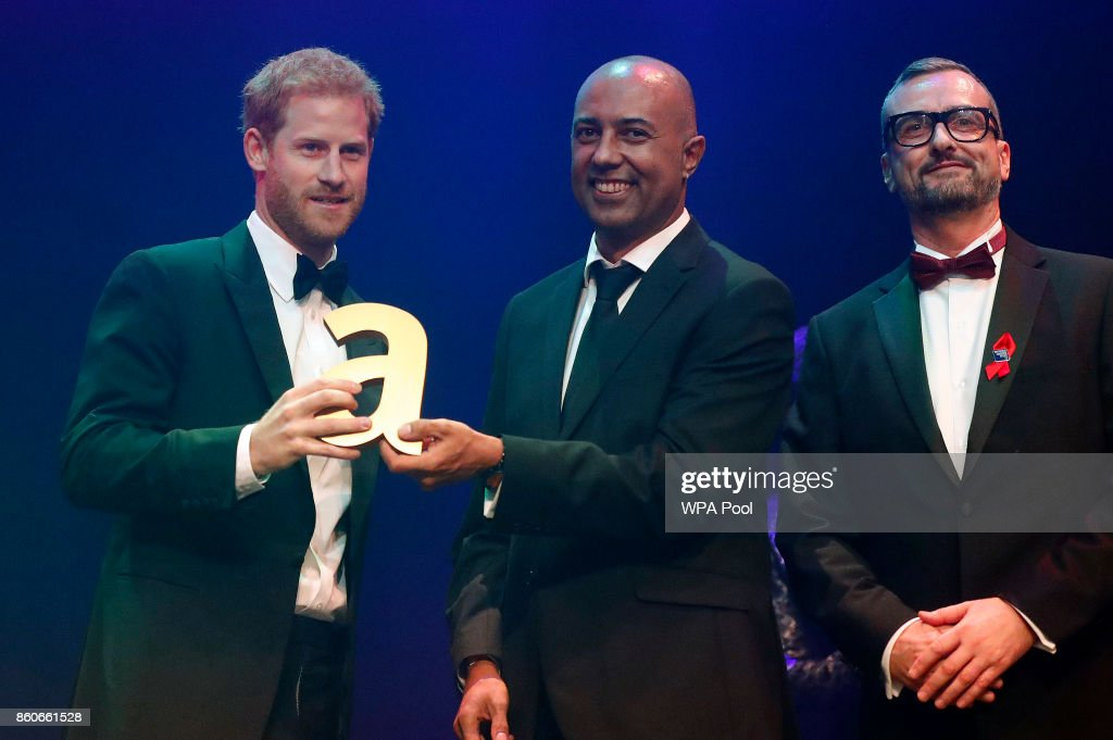 Prince Harry, left, receives a posthumous Attitude Legacy Award on behalf of his mother Diana, Princess of Wales, from Ian Walker, right, and Julian La Bastide at the Attitude Awards on October 12, 2017 in London, England. Attitude Magazine is awarding the prize to the late Princess Diana in honour of her significant work in drawing attention to HIV