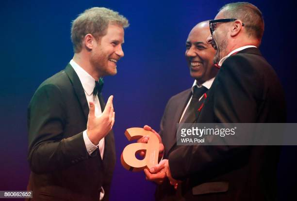 Prince Harry left receives a posthumous Attitude Legacy Award on behalf of his mother Diana Princess of Wales from Ian Walker right and Julian La...