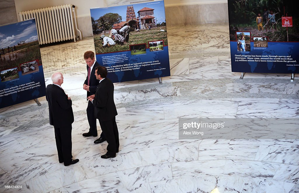 Prince Harry (2nd L) listens to HALO Trust Director Guy Willoughby (R) as he tours an exhibit on landmines and unexploded ordnances, escorted by U.S. Senator John McCain (L), inside the Rotunda of Russell Senate Office Building on Capitol Hill during the first day of his visit to the United States May 9, 2013 in Washington, DC. HRH will be undertaking engagements on behalf of charities with which the Prince is closely associated on behalf also of HM Government, with a central theme of supporting injured service personnel from the UK and US forces.