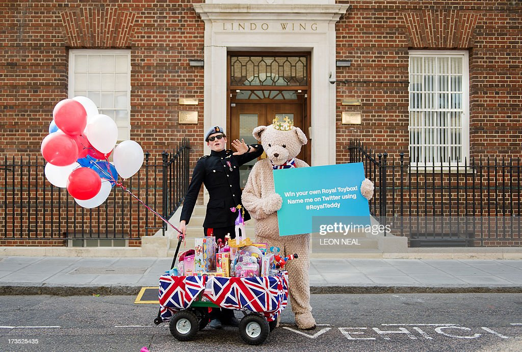 A 'Prince Harry lookalike' poses for a publicity stunt outside the Lindo Wing of Saint Mary's Hospital in London, on July 16, 2013, where Britain's Prince William and his wife Catherine's baby is expected to be born. Britain's Prince Charles joked Monday that his son Prince William's baby was 'hopefully' on the way, but wife Camilla went further, saying it could arrive 'by the end of the week'. AFP PHOTO / LEON NEAL