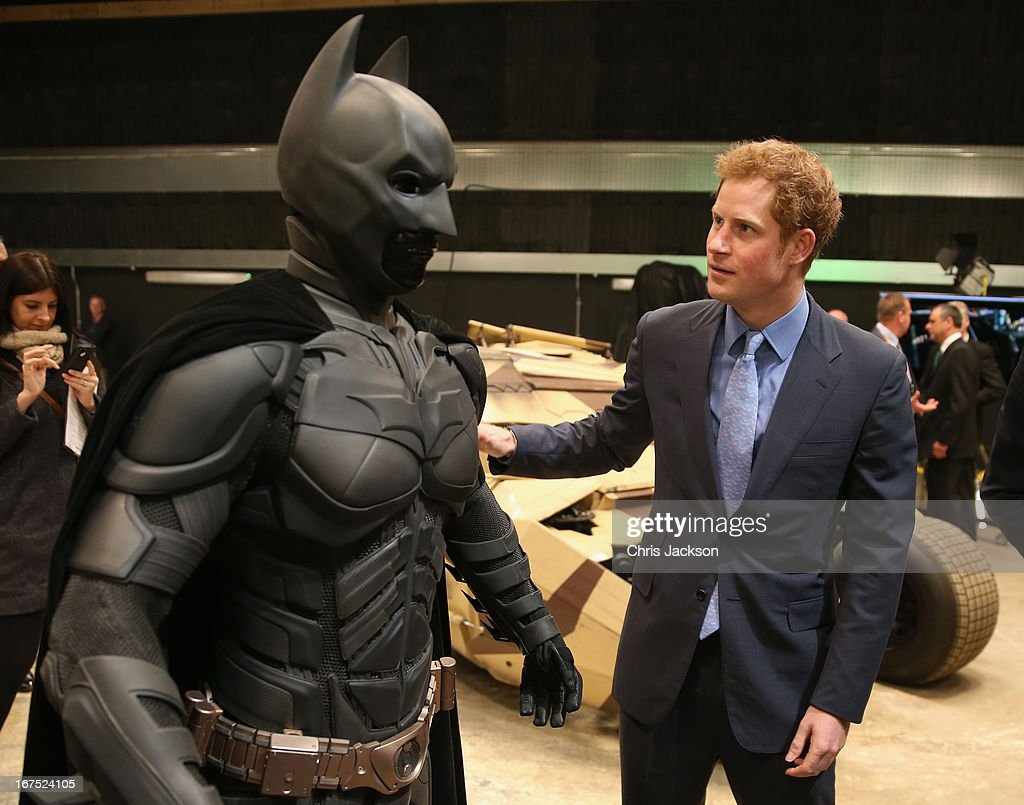 Prince Harry looks at a 'Batsuit' which was use in the Batman films during the Inauguration Of Warner Bros Studios Leavesden on April 26 2013 in...