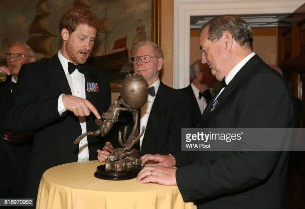 Prince Harry looks at maquette of the monument during a reception at Trinity House in London for Project Vernon a campaign to install a monument...