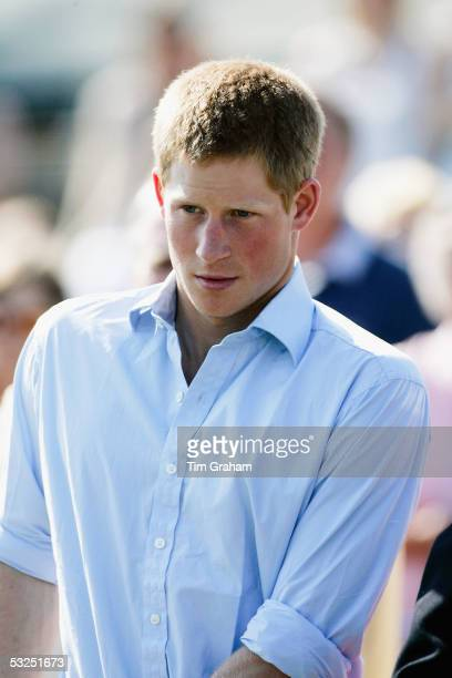 Prince Harry looks on at Cirencester Park Polo Club before playing a match for the Emlor team against the Corramore team Cirencester Park July 17...