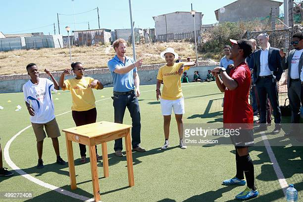 Prince Harry looks on during a visit to a Football for Hope session with Grassroots Soccer in Khayelitsha on November 30 2015 in Cape Town South...