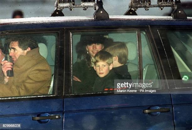 Prince Harry looks out of a car window as his brother Prince William talks with Tiggy LeggeBourke They had all arrived at Zurich Airport en route to...