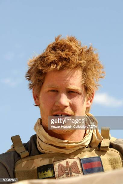 Prince Harry looks thoughtful in the desert on February 20 2008 in Helmand Province Afghanistan