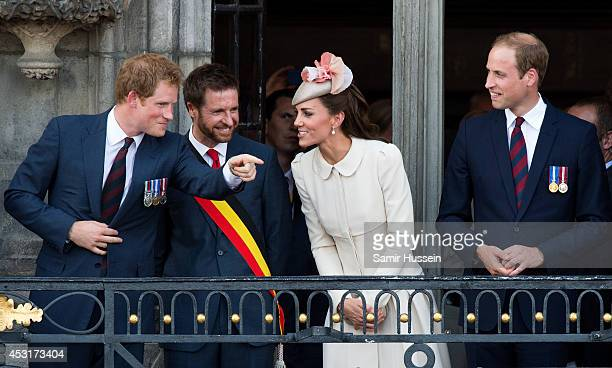 Prince Harry makes a joke as Nicolas Martin Acting Mayor of Mons Catherine Duchess of Cambridge and Prince William Duke of Cambridge look on from the...