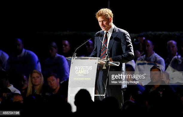 Prince Harry makes a speech as he attends the Opening Ceremony of the Invictus Games at the Queen Elizabeth Olympic Park on September 10 2014 in...