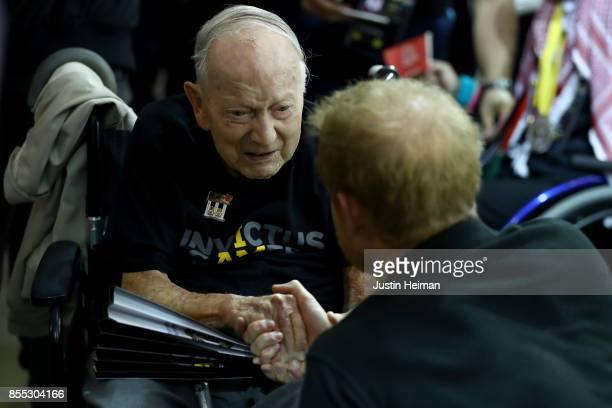 Prince Harry meets 102 year old World War II veteran Norm Baker prior to the Wheelchair Rugby Final during the Invictus Games 2017 at Mattamy...