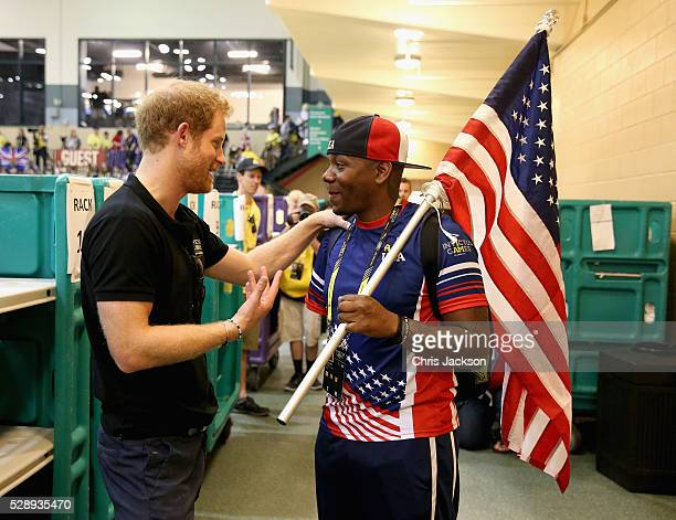 Prince Harry meets a USA supporter at the sitting volleyball at Invictus Games Orlando 2016 at ESPN Wide World of Sports on May 7 2016 in Orlando...