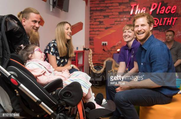 Prince Harry meets Audrey Frantzich and her parents Herman and Louise as he visits Leeds Children's Hospital during an official visit to Leeds on...
