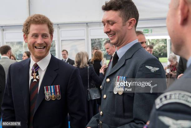 Prince Harry meets British military personnel at a reception following the unveiling of the new memorial to members of the armed services who served...