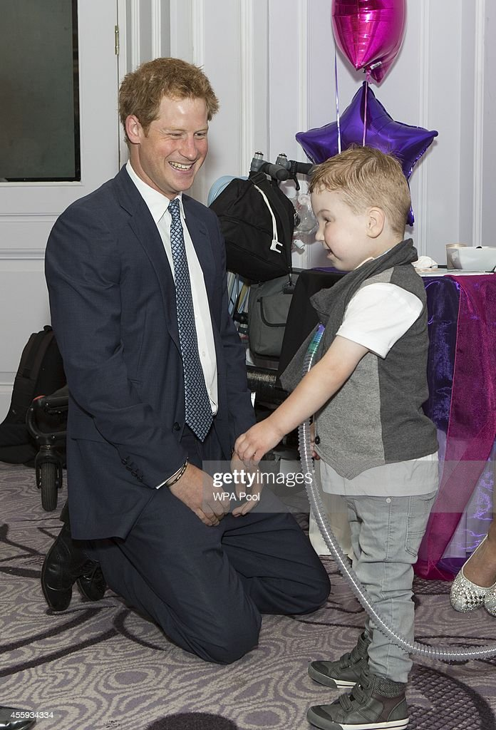 Prince Harry meets Carson Hartley (4) who suffers from lung disease, heart defect, Spina bifida and brittle bone disease, during the WellChild awards at the London Hilton on September 22, 2014 in London, England.