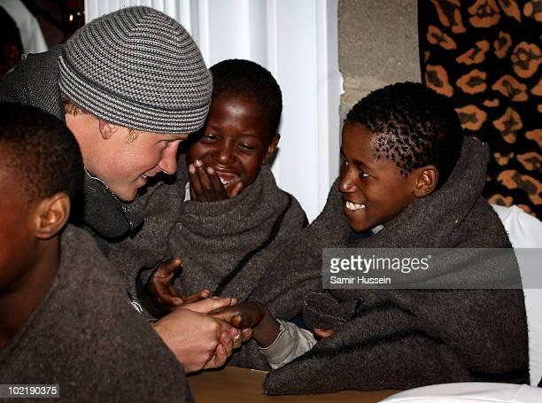Prince Harry meets children at the Herd Boy School on June 17 2010 in Semonkong Lesotho The Princes are on a joint trip to Southern Africa to visit...