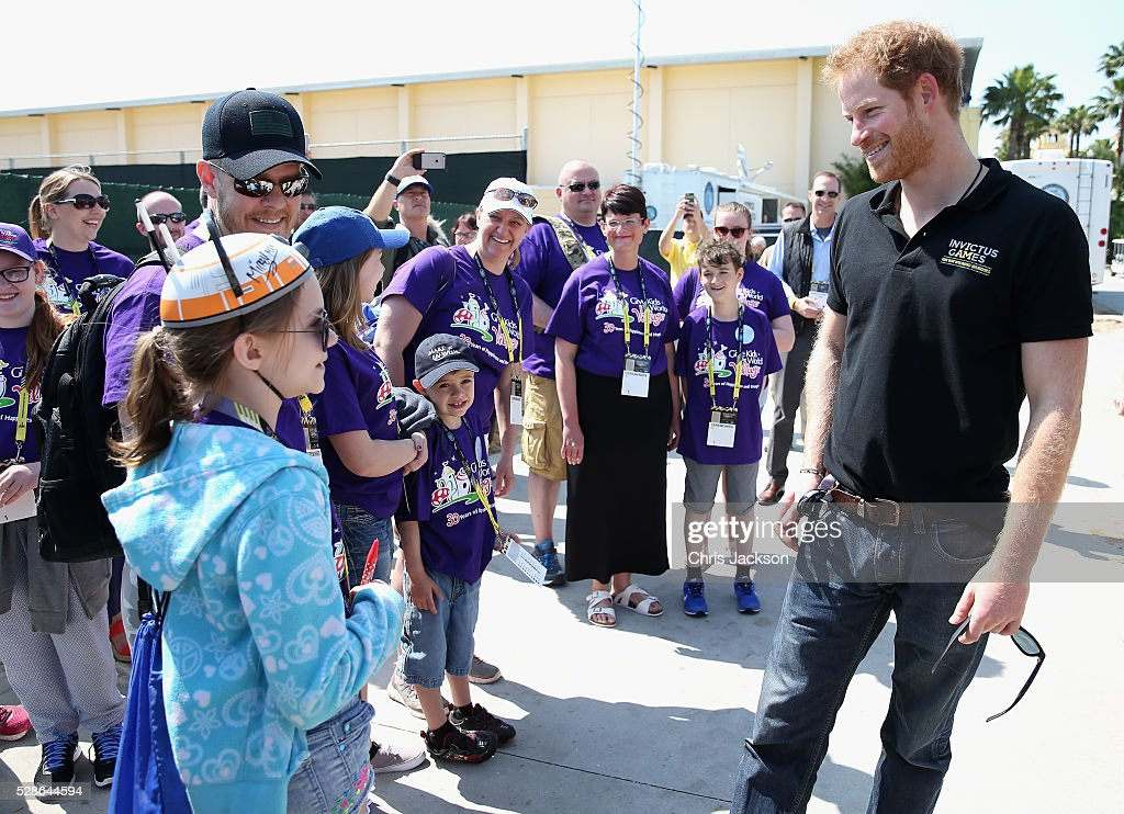 <a gi-track='captionPersonalityLinkClicked' href=/galleries/search?phrase=Prince+Harry&family=editorial&specificpeople=178173 ng-click='$event.stopPropagation()'>Prince Harry</a> meets children from 'Give Kids the World Village' as he visits venues ahead of Invictus Games Orlando 2016 at ESPN Wide World of Sports on May 6, 2016 in Orlando, Florida. <a gi-track='captionPersonalityLinkClicked' href=/galleries/search?phrase=Prince+Harry&family=editorial&specificpeople=178173 ng-click='$event.stopPropagation()'>Prince Harry</a>, patron of the Invictus Games Foundation is in Orlando ahead of the opening of Invictus Games which will open on Sunday. The Invictus Games is the only International sporting event for wounded, injured and sick servicemen and women. Started in 2014 by <a gi-track='captionPersonalityLinkClicked' href=/galleries/search?phrase=Prince+Harry&family=editorial&specificpeople=178173 ng-click='$event.stopPropagation()'>Prince Harry</a>, the Invictus Games uses the power of Sport to inspire recovery and support rehabilitation.