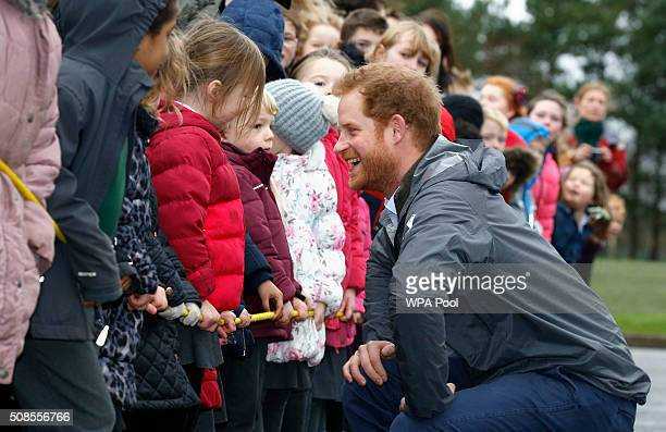 Prince Harry meets children from Weeton Primary School and Honeypots Nursery during a visit to Weeton Barracks on February 5 2016 in Blackpool...