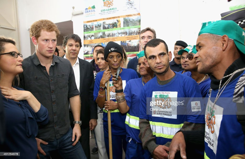 Prince Harry (alongside Mayor of Sao Paulo Fernando Haddad) meets crack-addict street cleaners during a visit to 'Cracolandia', an extremely deprived area of Sao Paulo with a high concentration of crack addicts on June 26, 2014 in Sao Paulo Brazil. Crack in Sao Paulo costs just 80 UK pence for a rock of the drug. Prince Harry is on a four day tour of Brazil that will be followed by Two days in Chile.