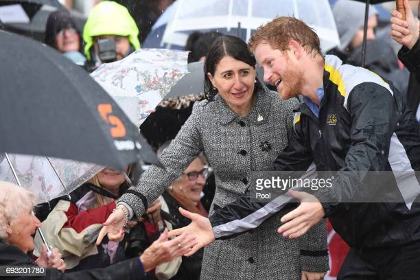 Prince Harry meets Daphne Dunne during a walk around The Rocks alongside NSW Premier Gladys Berejiklian on June 7 2017 in Sydney Australia Prince...
