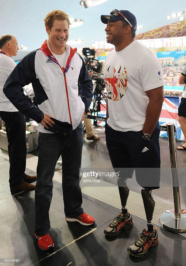 <a gi-track='captionPersonalityLinkClicked' href=/galleries/search?phrase=Prince+Harry&family=editorial&specificpeople=178173 ng-click='$event.stopPropagation()'>Prince Harry</a> meets former soldier and Paralympic athlete Derek Derenalagi during his visit to the Aquatics Centre where he watched the swimming heats on day 6 of the London 2012 Paralympic Games at the Aquatics Centre on September 4, 2012 in London, England.