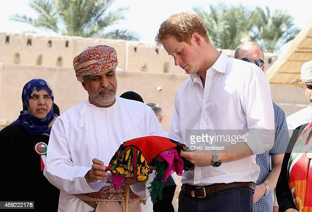 Prince Harry meets local craftsmen during a visit to Nizra Fort on November 19 2014 in Muscat Oman Prince Harry is on a three day visit to Oman...