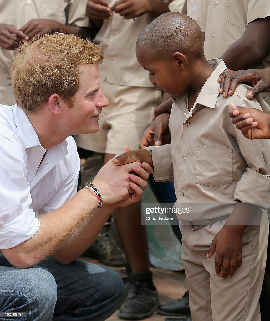 Prince Harry meets partially sighted children at St Bernadette's Centre for the blind a project supported by his charity Sentebale on February 27, 2013 in Maseru, Lesotho. Sentebale is a charity founded by Prince Harry and Prince Seeiso of Lesotho. It helps the most vulnerable children in Lesotho get the support they need to lead healthy and productive lives. Sentebale works with local grassroots organisations to help these children, the victims of extreme poverty and Lesotho's HIV/AIDS epidemic. Cathy Ferrier was appointed as Sentebale's Chief Executive in March 2012 and is spearheading a fundraising initiative to build the Mamohato Centre which will provide psychosocial support for children and young people infected with HIV. Prince Harry is due to pay a visit to Lesotho this week to catch up on his charity's progress and meet key children who will be supported by the charity.