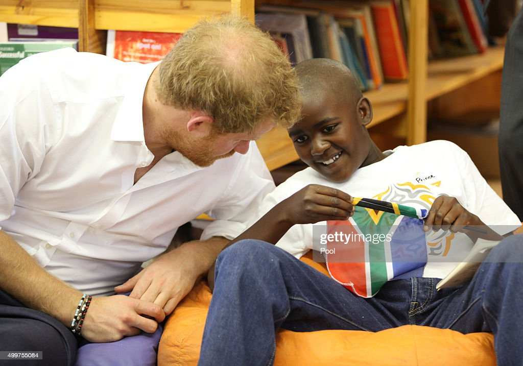 Prince Harry meets Prince mtimkulul as he visits Siyabonga Secondary School and meets children participating in the Nelson Mandela Champion within program in Soweto on December 3, 2015 in Johannesburg, South Africa. Prince Harry is visiting South Africa as part of a Royal Tour that has included the Opening of a new Charity Centre for children in Lesotho (Sentebale's Mamohato Children's Centre) and includes stops in Durban, Cape Town, Kruger National Park and Johannesburg.
