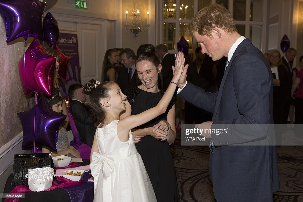 Prince Harry meets Rachel Hooley (10), Inspirational child award winner 7-11, during the WellChild awards at the London Hilton on September 22, 2014 in London, England.