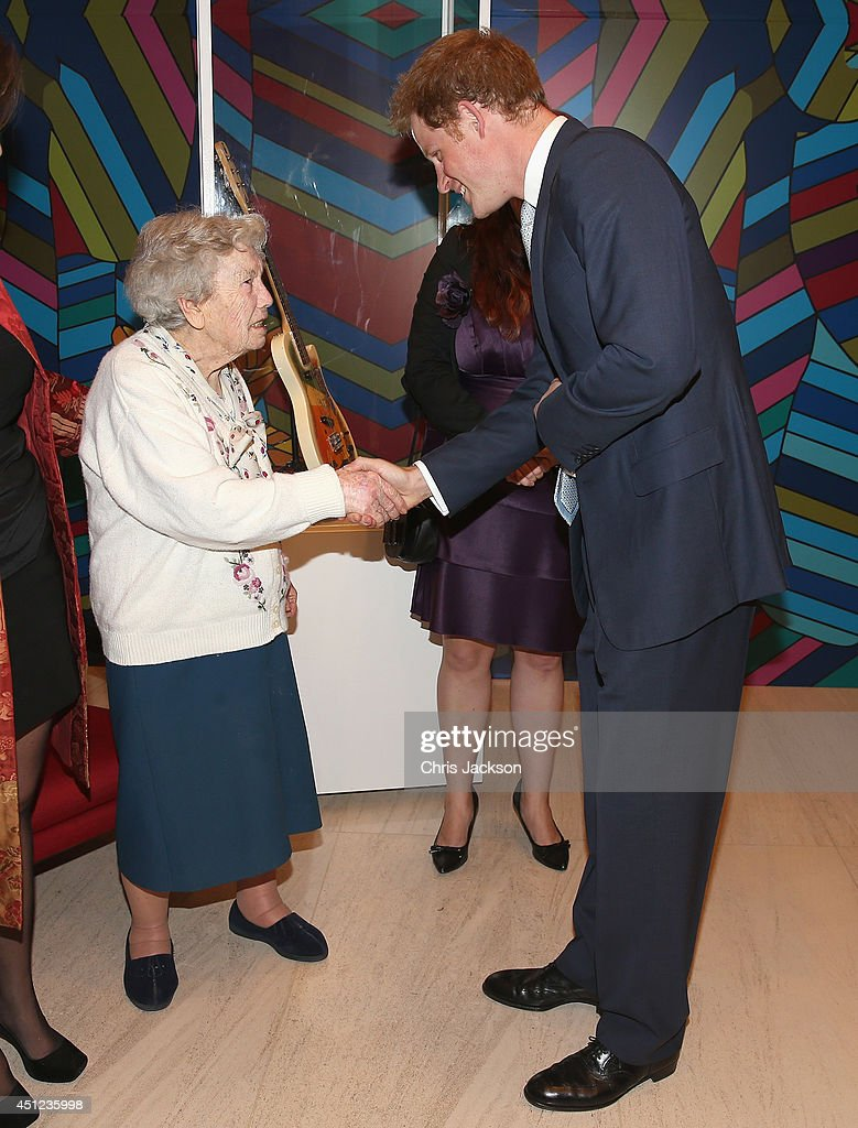 <a gi-track='captionPersonalityLinkClicked' href=/galleries/search?phrase=Prince+Harry&family=editorial&specificpeople=178173 ng-click='$event.stopPropagation()'>Prince Harry</a> meets Sao Paulos oldest member of the British Community Gertrude Viger, aged 102, at a GREAT Britain reception on June 25, 2014 in Sao Paulo Brazil. <a gi-track='captionPersonalityLinkClicked' href=/galleries/search?phrase=Prince+Harry&family=editorial&specificpeople=178173 ng-click='$event.stopPropagation()'>Prince Harry</a> is on a four day tour of Brazil that will be followed by Two days in Chile.