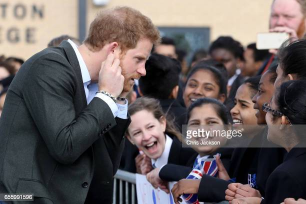 Prince Harry meets school children during a visit to Hamilton College on March 21 2017 in Leicester England