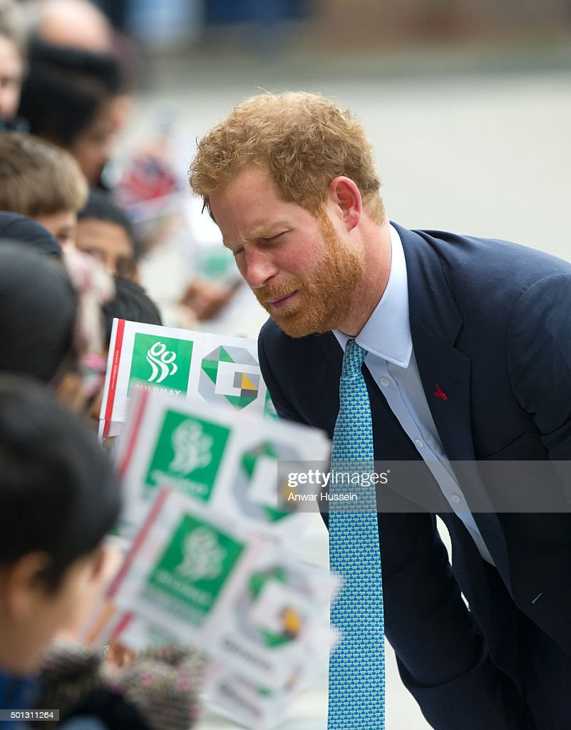 Prince Harry meets school children during a visit to Mildmay Hospital, a dedicated HIV hospital on December 14, 2015 in London, England.