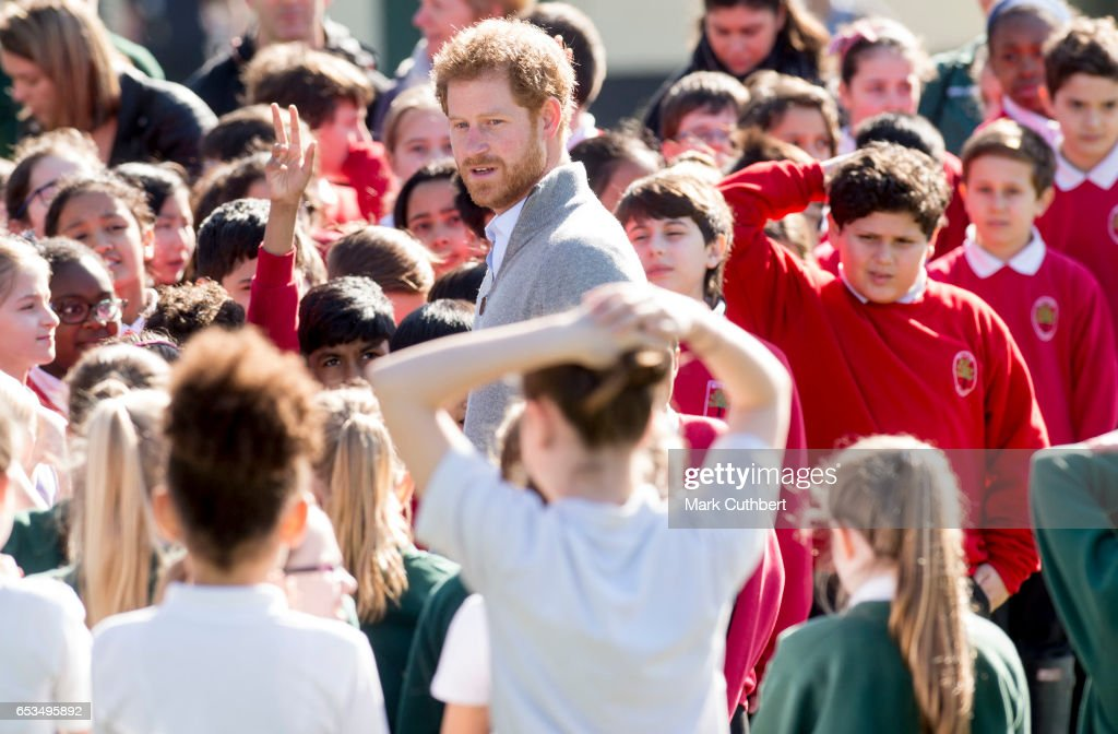 prince-harry-meets-school-children-under-the-queens-oak-tree-during-a-picture-id653495892