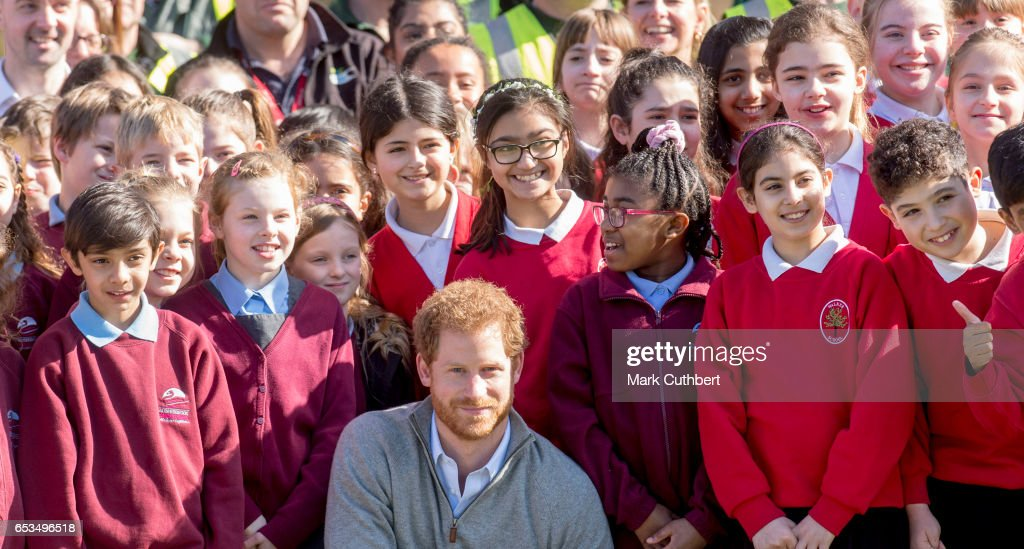 prince-harry-meets-school-children-under-the-queens-oak-tree-during-a-picture-id653496518