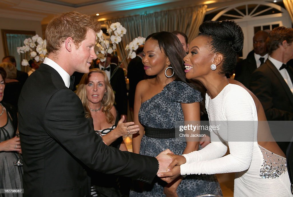 Prince Harry meets South African model Bonang Matheba at the Sentebale Gala Dinner at Summer Place on February 27, 2013 in Johannesburg, South Africa. Sentebale is a charity founded by Prince Harry and Prince Seeiso of Lesotho. It helps the most vulnerable children in Lesotho get the support they need to lead healthy and productive lives. Sentebale works with local grassroots organisations to help these children, the victims of extreme poverty and Lesotho's HIV/AIDS epidemic.
