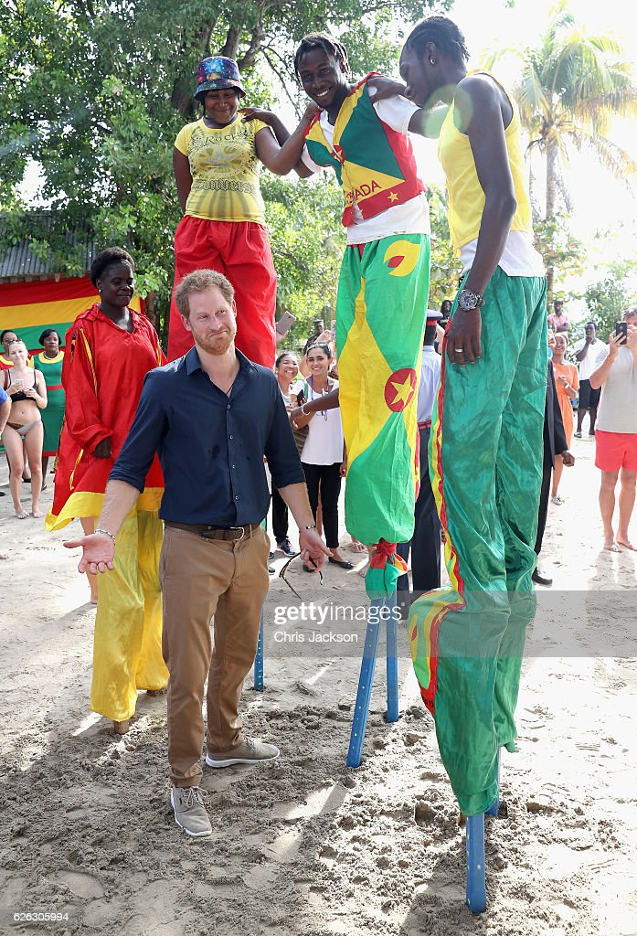 Prince Harry meets stilt walkers on Grand Anse Beach as he visits Mangrove restoration projects ahead of visiting the coral reef on the ninth day of an official visit to the Caribbean on November 28, 2016 in St Georges, Grenada. Prince Harry's visit to The Caribbean marks the 35th Anniversary of Independence in Antigua and Barbuda and the 50th Anniversary of Independence in Barbados and Guyana.